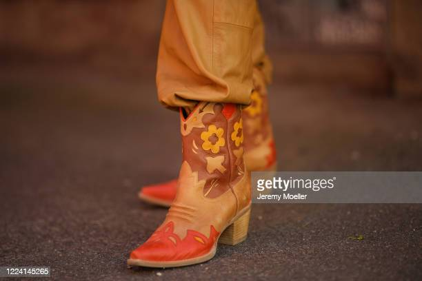 Lea Neumann wearing Jeffrey Campbell cowboy boots and Gestuz overall on May 06, 2020 in Berlin, Germany.