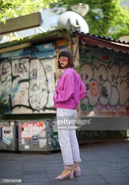 Lea Neumann wearing Levis jeans, essential Antwerp heels and Dior vintages shades on May 06, 2020 in Berlin, Germany.