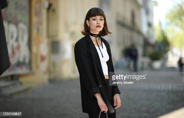 Lea Neumann wearing Prada bag and complete H&M look on May 06, 2020 in Berlin, Germany.