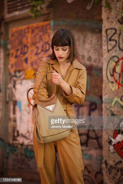 Lea Neumann wearing Prada bag, Jeffrey Campbell cowboy boots and Gestuz overall on May 06, 2020 in Berlin, Germany.