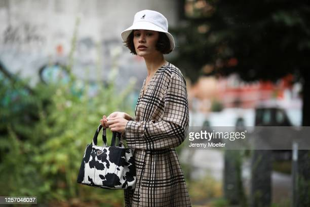 Lea Neumann wearing Prada bag, Weekday dress and Kangol bucket hat on July 15, 2020 in Berlin, Germany.