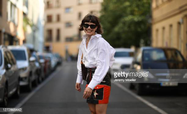 Lea Neumann wearing white shirt, leather vintage skirt, Louis Vuitton bag and Messy Weekend shades on September 12, 2020 in Berlin, Germany.