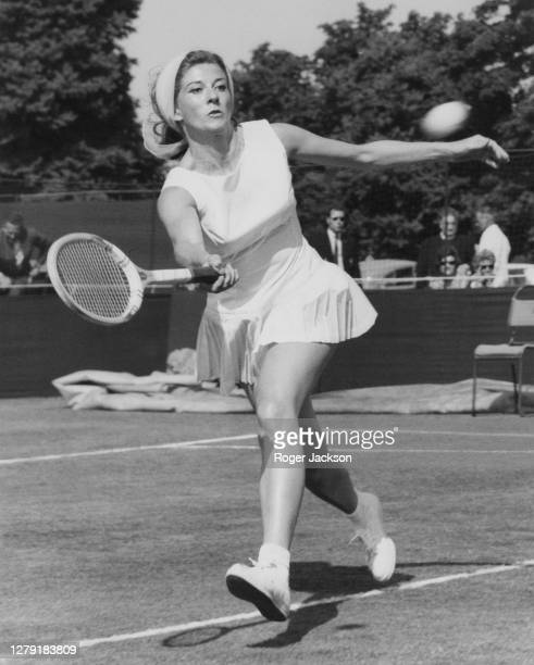 Lea Pericoli of Italy plays a fore hand return to Carole Rosser of Great Britain during their Women's Singles First Round match at the Kent Tennis...
