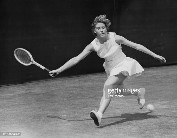 Lea Pericoli of Italy plays a forehand return to María Josefa de Riba of Spain during their Women's Singles Second Round match at the Wimbledon Lawn...