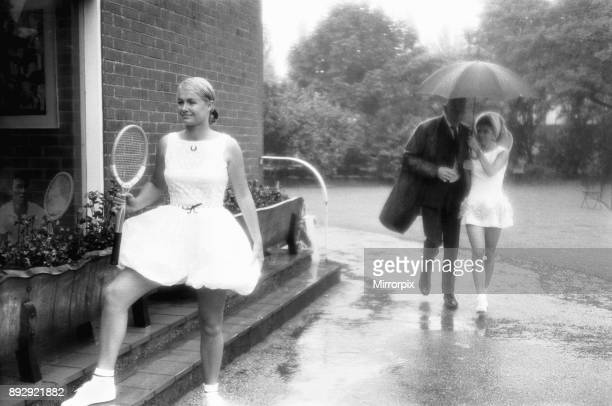 Lea Pericoli v Susanna Alexander at the rain soaked pre Wimbledon garden party at the Hurlingham Club The girls were there braving the deluge to show...