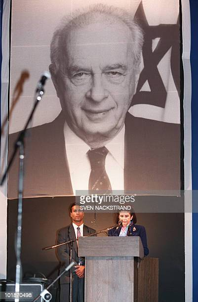Lea Rabin wife of assassinated Israeli Premier Yitzhak Rabin reads eulogies for her husband during a gathering in his memory 12 November 1995 in Tel...