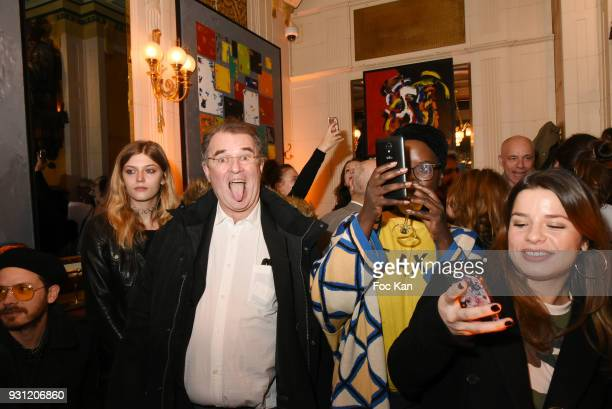 Lea Rostain and her father photographer Pascal Rostain attend Marc Cerrone Exhibition Preview at Deux Magots a on March 12 2018 in Paris France