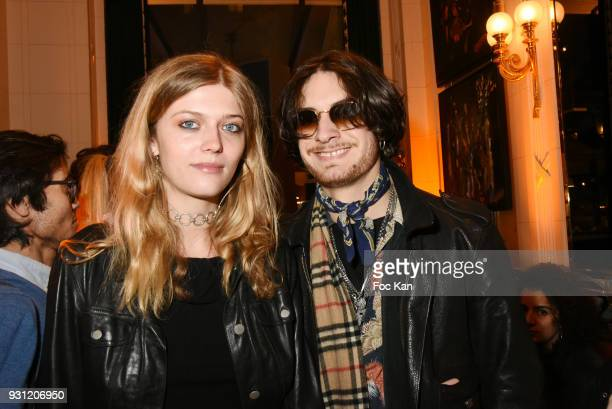 Lea Rostain and Quentin Pontonnier attend Marc Cerrone Exhibition Preview at Deux Magots a on March 12 2018 in Paris France
