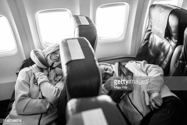 Lea Schueller and Melanie Leupolz of Germany rest during a flight from Lille to Montepellier on June 13 2019 in France