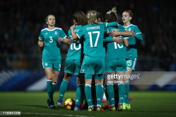 Lea Schueller of Germany celebrates his team's first goal with team mates during the Women's International Friendly match between France Women and...