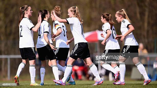 Lea Schueller of Germany celebrates with team mates as Silke Vanwynsberghe of Belgium scores an own goal during the U19 Women's Elite Round match...