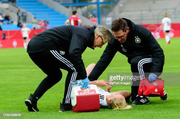 Lea Schueller of Germany receives medical treatment during the FIFA Women's World Cup 2023 Qualifier group H match between Germany and Serbia at...