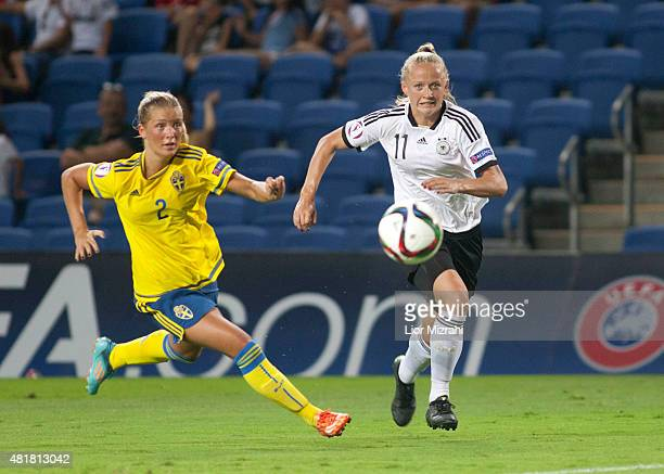 Lea Schuller of Germany challenges Ronja Aronsson of Sweden during the UEFA Women's Under19 European Championship semi final between U19 Germany and...