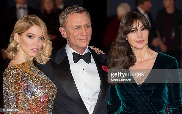 Lea Seydoux and Monica Bellucci with Daniel Craig attend the Royal Film Performance of 'Spectre' at Royal Albert Hall on October 26 2015 in London...