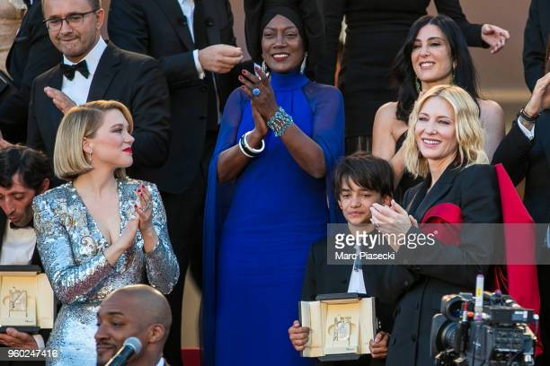 Lea Seydoux Khadja Nin Cate Blanchett and director Nadine Labaki look on as Sting and Shaggy perform on the red carpet steps during the closing...