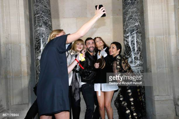 Lea Seydoux stylist Nicolas Ghesquiere Riley Keough and Ruth Negga pose after the Louis Vuitton show as part of the Paris Fashion Week Womenswear...