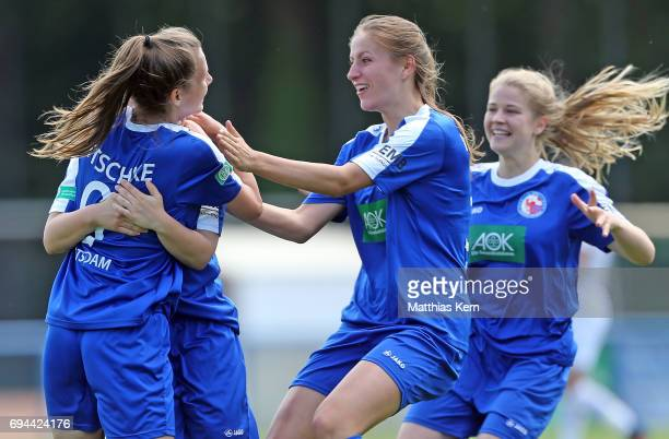 Lea Sophie Bahnemann jubilates with team mates after scoring the first goal during the B Junior Girl's German Championship semi final match between...
