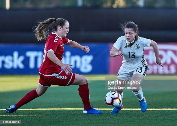 Lea Sophie Bahnemann of Germany competes for the ball with Janni Thomsen of Denmark during the 14 Nations Tournament match between U19 Women's...