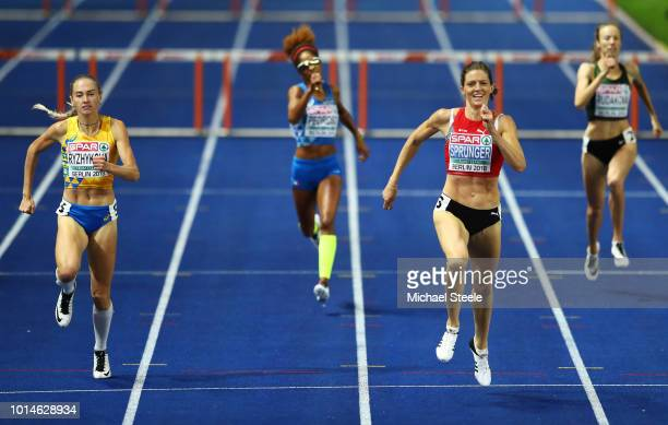 Lea Sprunger of Switzerland and Anna Ryzhykova of Ukraine compete in the Women's 400m Hurdles Final during day four of the 24th European Athletics...