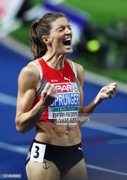 Lea Sprunger of Switzerland celebrates after winning Gold in the Women's 400m Hurdles Final during day four of the 24th European Athletics...