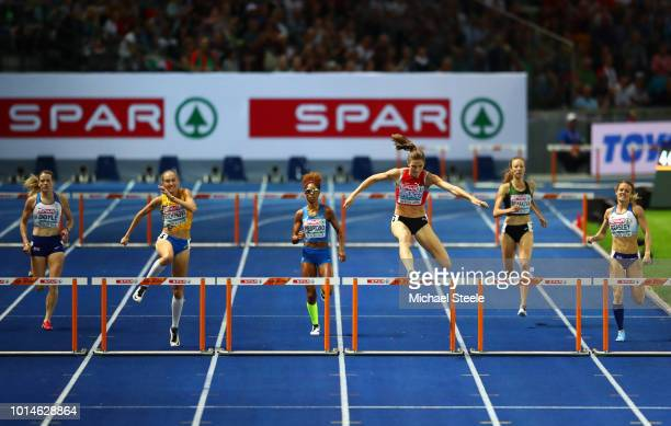Lea Sprunger of Switzerland Yadisleidy Pedroso of Italy and Anna Ryzhykova of Ukraine compete in the Women's 400m Hurdles Final during day four of...