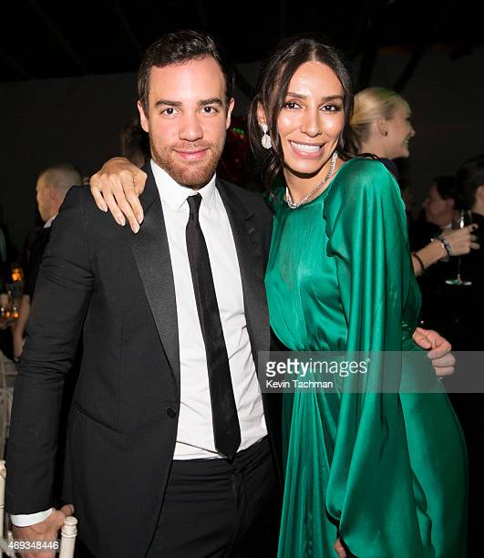 Lea T and guest attend the 5th Annual amfAR Inspiration Gala at the home of Dinho Diniz on April 10 2015 in Sao Paulo Brazil