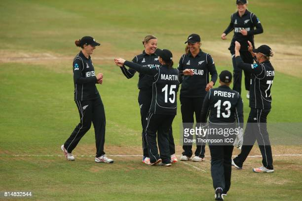 Lea Tahuhu of New Zealand celebrates with Katey Martin of New Zealand after taking the wicket of Punham Raut of India during the ICC Women's World...
