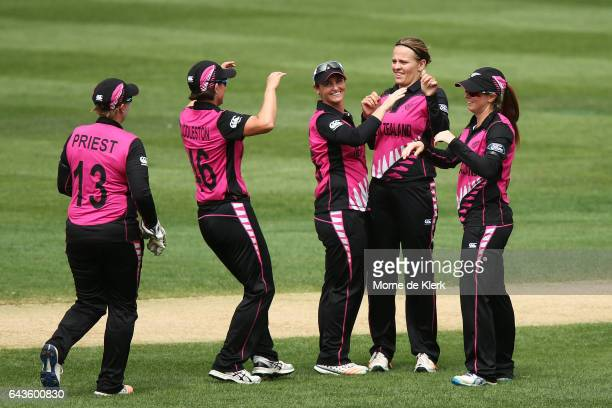 Lea Tahuhu of New Zealand celebrates with teammates after getting the wicket of Ashleigh Gardner of Australia during the Women's Twenty20...