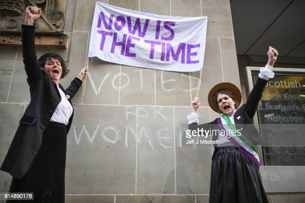 Lea Taylor and Nicola Wright dressed in Suffragettes costume hold a mock protest on the Royal Mile on February 6 2018 in Edinburgh Scotland The event...