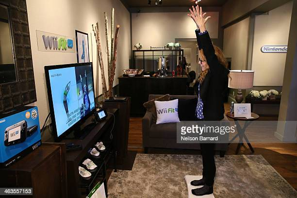 Lea Thompson gets her hands on Wii Fit U while at the Nintendo Chalet during the 2014 Sundance Film Festival on January 18 2014 in Park City Utah