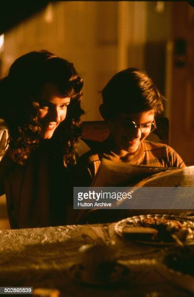 Lea Thompson smiles with Lukas Haas in a scene from the movie 'The Wizard of Loneliness' circa 1988