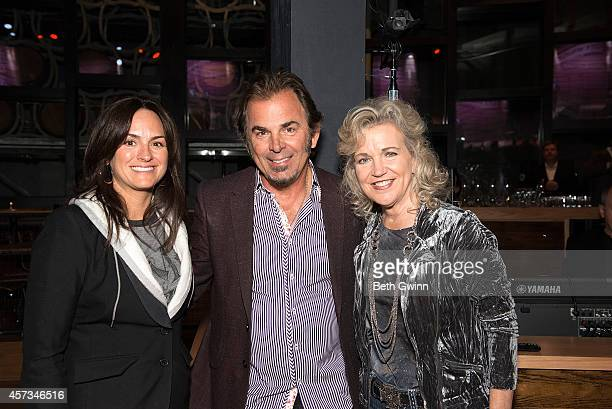 LeaAnn Phelan of ASCAP Jonathan Cain and Lisa Harless attends the MakeAWish VIP preview party at City Winery Nashville on October 16 2014 in...
