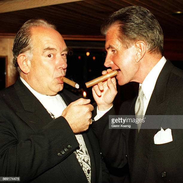 LSLeach/George1003GK–left to rightTV personsonality Robin Leach and Actor George Hamilton puff on cigars during the James Beard Foundation of New...