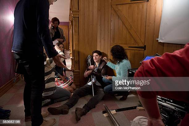 Lead actor Finney Cassidy who plays Cameron pictured on the set of Evermoor with costar Naomi Sequeira and director Chris Cottam during shooting at a...