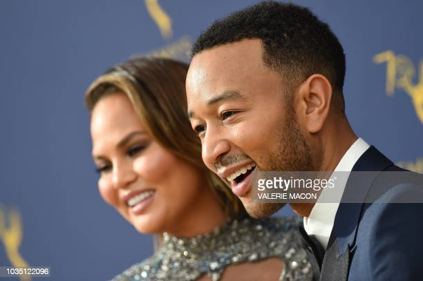 Lead actor in a limited series or movie nominee John Legend and his wife model Chrissy Teigen arrive for the 70th Emmy Awards at the Microsoft...