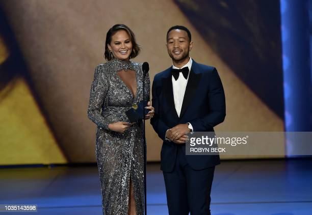 Lead actor in a limited series or movie nominee John Legend and his wife Chrissy Teigen onstage during the 70th Emmy Awards at the Microsoft Theatre...