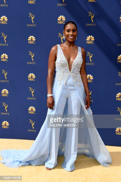 Lead actress in a comedy series nominee Issa Rae arrives for the 70th Emmy Awards at the Microsoft Theatre in Los Angeles California on September 17...