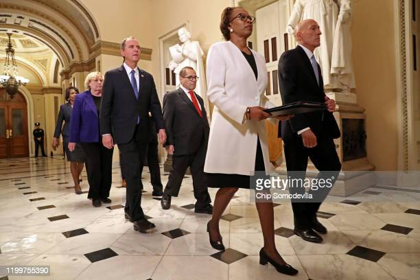 Lead by House of Representatives Clerk Cheryl Johnson and House Sergeant at Arms Paul Irving, impeachment managers Rep. Hakeem Jeffries , Rep. Sylvia...