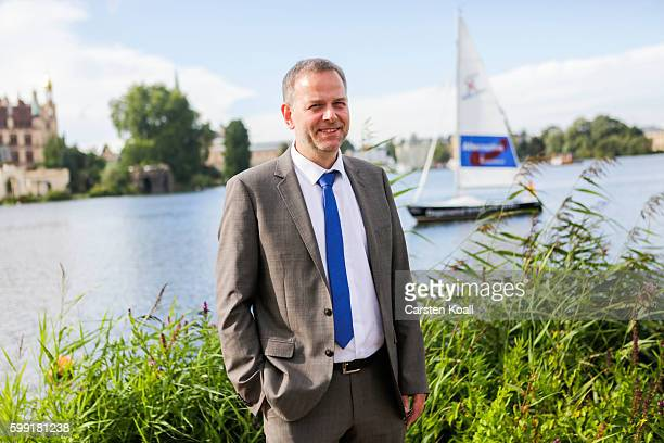 Lead candidate LeifErik Holm of the Alternative for Germany a newcomer populist party that also attracts rightwing voters poses for the press before...
