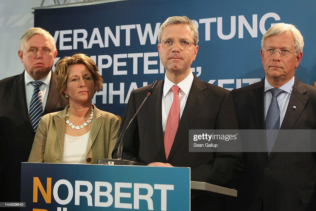 Lead candidate of the German Christian Democrats (CDU) Norbert Roettgen (2nd from R), flanked by his wife Ebba and other local leading CDU members, announces his resignation as state CDU Chairman following disastrous election results in the German state of North Rhine-Westphalia on May 13, 2012 in Dusseldorf, Germany. Initial polls give the CDU 26%, far behind the German Social Democrats (SPD), with 39% . The result is a significant setback for CDU national Chairwoman and German Chancellor Angela Merkel.