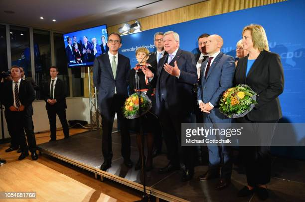 Lead candidate of the German Christian Democrats Volker Bouffier speaks to supporters after the initial election results at the Hesse state...