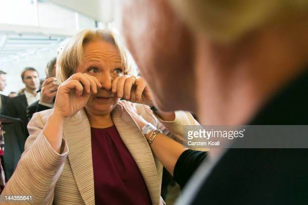 Lead candidate of the German Social Democrats Hannelore Kraft cries between television interviews following elections in the German state of North...