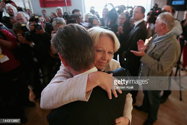 Lead candidate of the German Social Democrats Hannelore Kraft gets a hug from Norbert Roemer head of the SPD faction in the North RhineWestphalia...