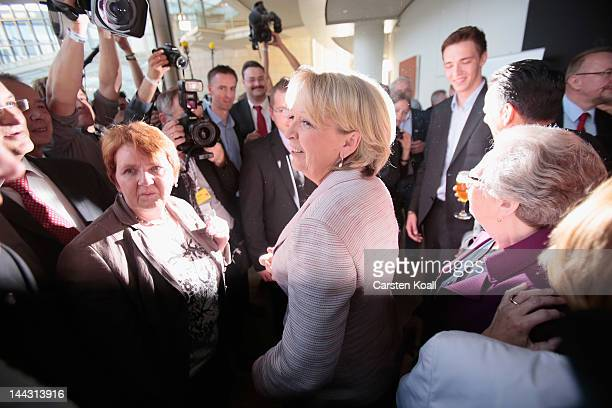 Lead candidate of the German Social Democrats Hannelore Kraft greets supporters while walking to the next television interview at the North...