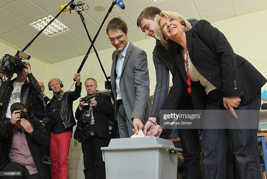 Lead candidate of the German Social Democrats (SPD) Hannelore Kraft (R), her husband Udo and her son Jan cast their ballot at a polling station, during elections in the German state of North Rhine-Westphalia on May 13, 2012 in Muehlheim an der Ruhr, Germany. The Social Democrats are favoured to receive the most votes in today's election in Germany's most populous state, a result that would create a significant setback for the German Christian Democrats (CDU), the party of Chancellor Angela Merkel.
