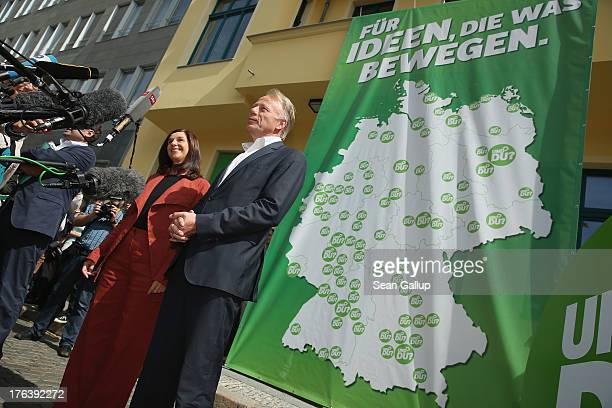 Lead candidates of the German Greens Party Juergen Trittin and Katrin GoeringEckardt speak to the media shortly before departing on their federal...