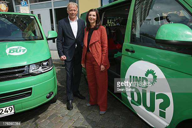 Lead candidates of the German Greens Party Juergen Trittin and Katrin GoeringEckardt pose for the media shortly before departing on their federal...