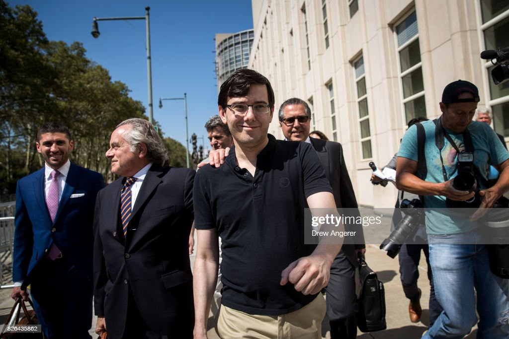 Lead defense attorney Benjamin Brafman walks with former pharmaceutical executive Martin Shkreli after the jury issued a verdict at the U.S. District Court for the Eastern District of New York, August 4, 2017 in the Brooklyn borough of New York City. Shkreli was found guilty on three of the eight counts involving securities fraud and conspiracy to commit securities and wire fraud.