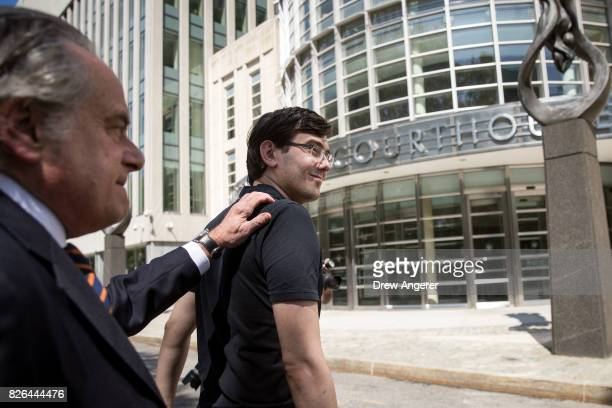 Lead defense attorney Benjamin Brafman walks with former pharmaceutical executive Martin Shkreli after the jury issued a verdict at the US District...