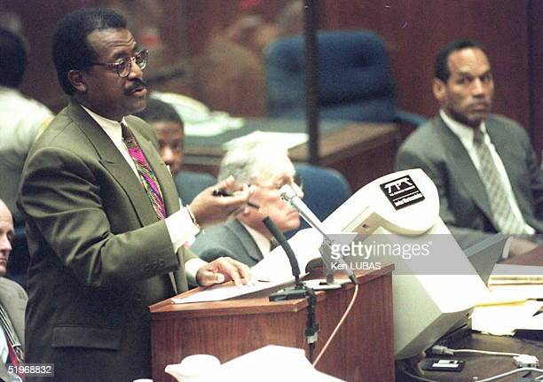Lead defense attorney Johnnie Cochran Jr talks to Judge Ito as defendant OJ Simpson listens during a court proceeding prior to the defense's opening...
